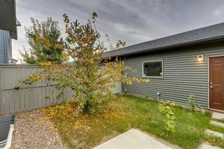 Photo 39: 72 Sunvalley Road: Cochrane Row/Townhouse for sale : MLS®# A1152230