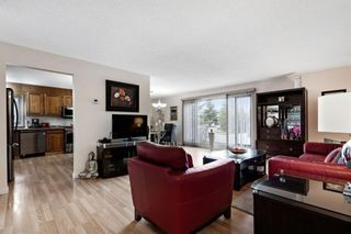 Photo 3: 7 Woodmont Rise SW in Calgary: Woodbine Detached for sale : MLS®# A1092046