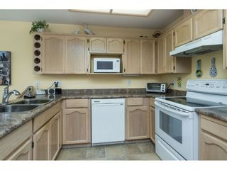"""Photo 5: 13 19649 53 Avenue in Langley: Langley City Townhouse for sale in """"Huntsfield Green"""" : MLS®# R2412498"""