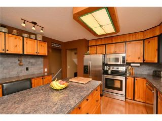 Photo 9: 34 GLENPATRICK Place: Cochrane House for sale : MLS®# C4055156