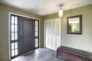 Photo 3: 155 HUNTFORD Road NE in Calgary: Huntington Hills Detached for sale : MLS®# A1016441