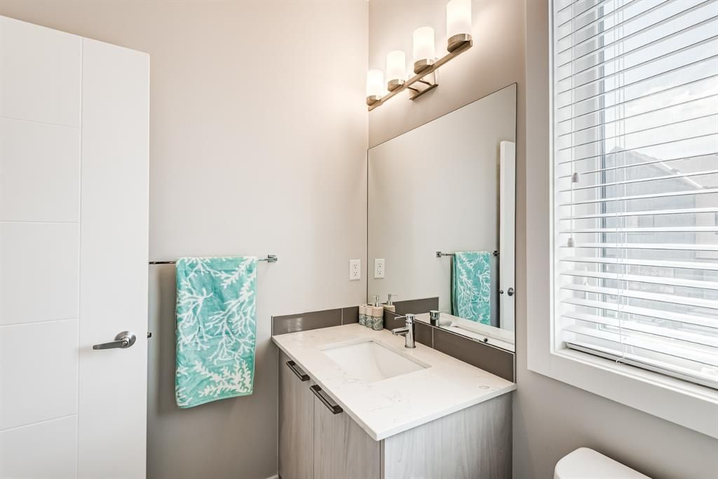 Photo 18: Photos: 125 Redstone Crescent NE in Calgary: Redstone Row/Townhouse for sale : MLS®# A1124721