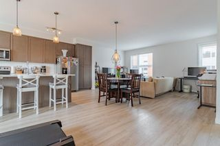 Photo 6: 145 Shawnee Common SW in Calgary: Shawnee Slopes Row/Townhouse for sale : MLS®# A1097036