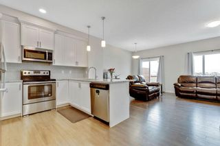 Photo 8: 333 Heartland Crescent: Cochrane Semi Detached for sale : MLS®# A1063240