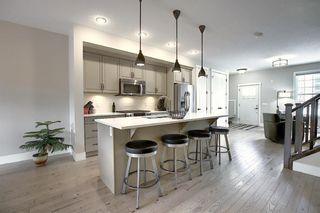 Photo 8: 374 Quarry Park Boulevard SE in Calgary: Douglasdale/Glen Row/Townhouse for sale : MLS®# A1063797