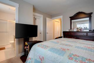 Photo 20: 15 West Coach Manor SW in Calgary: West Springs Row/Townhouse for sale : MLS®# A1100327
