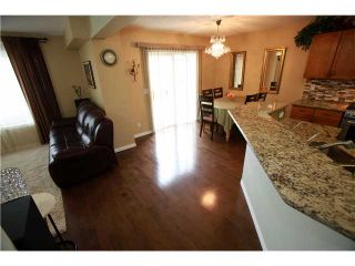 Photo 4: 144 ARBOUR STONE Crescent NW in CALGARY: Arbour Lake Residential Detached Single Family for sale (Calgary)  : MLS®# C3629309