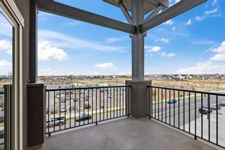 Photo 21: 7411 403 Mackenzie Way SW: Airdrie Apartment for sale : MLS®# A1152134
