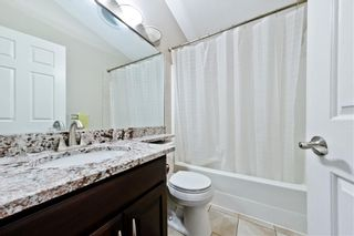 Photo 11: BRIDLEWOOD PL SW in Calgary: Bridlewood House for sale