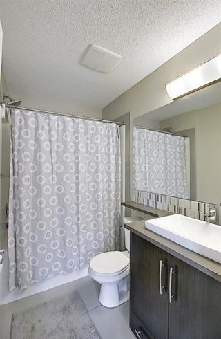Photo 17: 314 Ascot Circle SW in Calgary: Aspen Woods Row/Townhouse for sale : MLS®# A1111264