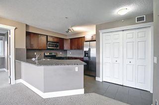 Photo 2: 108 500 Rocky Vista Gardens NW in Calgary: Rocky Ridge Apartment for sale : MLS®# A1136612