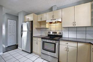 Photo 7: 455 Falconridge Crescent NE in Calgary: Falconridge Detached for sale : MLS®# A1103477