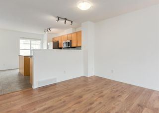 Photo 9: 311 Toscana Gardens NW in Calgary: Tuscany Row/Townhouse for sale : MLS®# A1133126