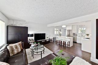 Photo 5: 805 67 Avenue SW in Calgary: Kingsland Detached for sale : MLS®# A1115484