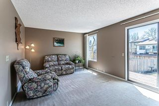 Photo 4: 1413 Ranchlands Road NW in Calgary: Ranchlands Row/Townhouse for sale : MLS®# A1133329
