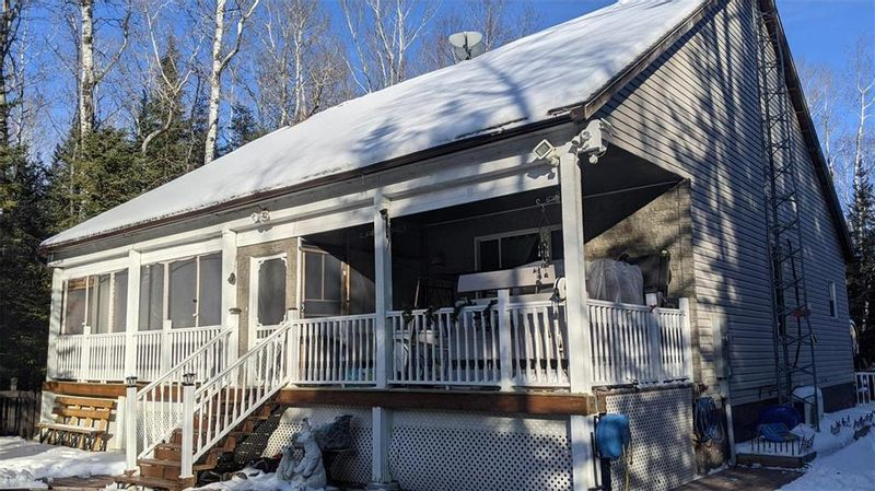 FEATURED LISTING: 6 Glen Abbey Cove Traverse Bay