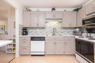 Photo 4: 213 20600 53A Avenue in Langley: Langley City Condo for sale : MLS®# R2593027