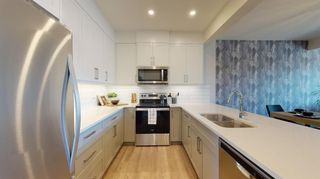 Photo 2: 509 Crestridge Common SW in Calgary: Crestmont Row/Townhouse for sale : MLS®# A1109996