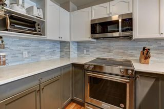 Photo 5: 15 12 Silver Creek Boulevard NW: Airdrie Row/Townhouse for sale : MLS®# A1090078
