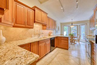 Photo 23: 20A Woodmeadow Close SW in Calgary: Woodlands Row/Townhouse for sale : MLS®# A1127050