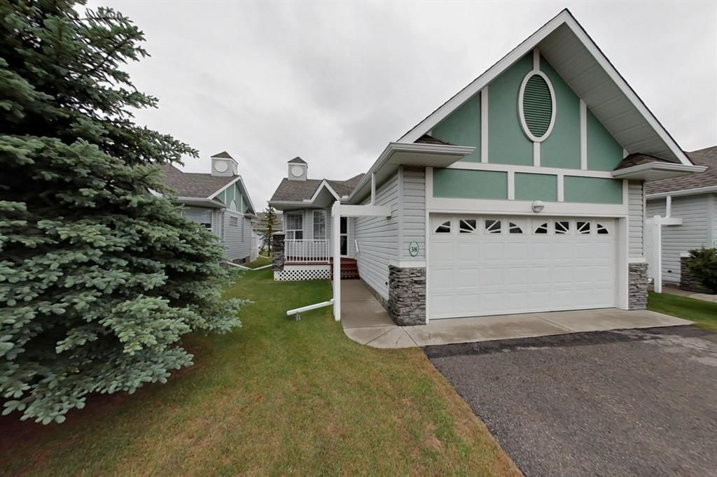Main Photo: 38 1008 Woodside Way NW: Airdrie Row/Townhouse for sale : MLS®# A1123458