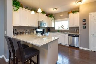 Photo 4: 160 CLYDESDALE Way: Cochrane House for sale : MLS®# C4137001