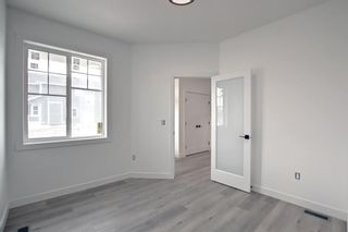 Photo 5: 126 Creekside Way SW in Calgary: C-168 Detached for sale : MLS®# A1144468