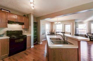 Photo 4: 492 Tuscany Ridge Heights NW in Calgary: House for sale : MLS®# C4036827
