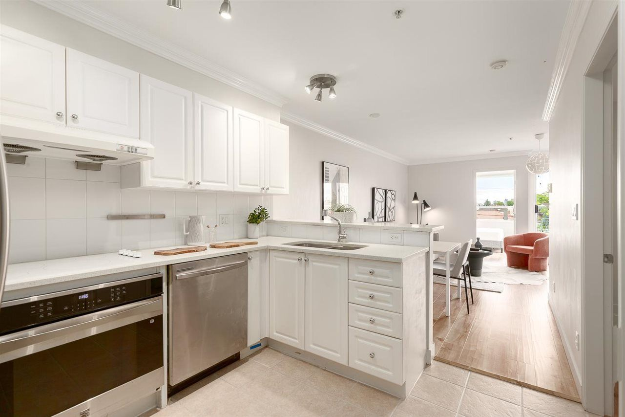 """Main Photo: PH20 5555 VICTORIA Drive in Vancouver: Victoria VE Condo for sale in """"Chez Victoria"""" (Vancouver East)  : MLS®# R2590777"""