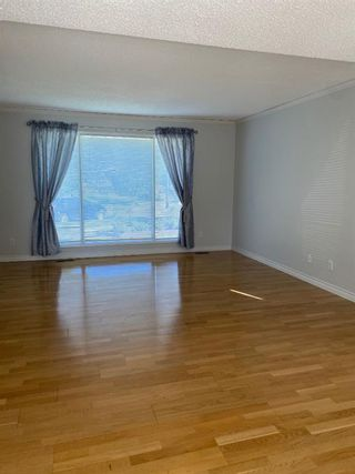 Photo 10: 554 STRATHCONA Drive SW in Calgary: Strathcona Park Semi Detached for sale : MLS®# A1020759