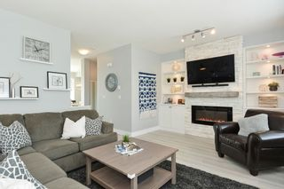 """Photo 2: 204 2450 161A Street in Surrey: Grandview Surrey Townhouse for sale in """"GLENMORE"""" (South Surrey White Rock)  : MLS®# R2277039"""