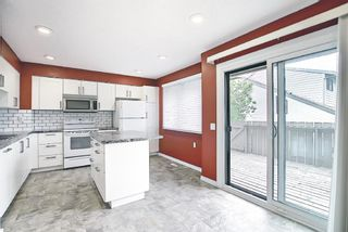 Photo 3: 8 3302 50 Street NW in Calgary: Varsity Row/Townhouse for sale : MLS®# A1120305