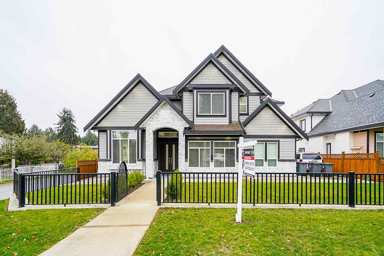 Main Photo: 13148 96 Avenue in Surrey: Queen Mary Park Surrey House for sale : MLS®# R2513032