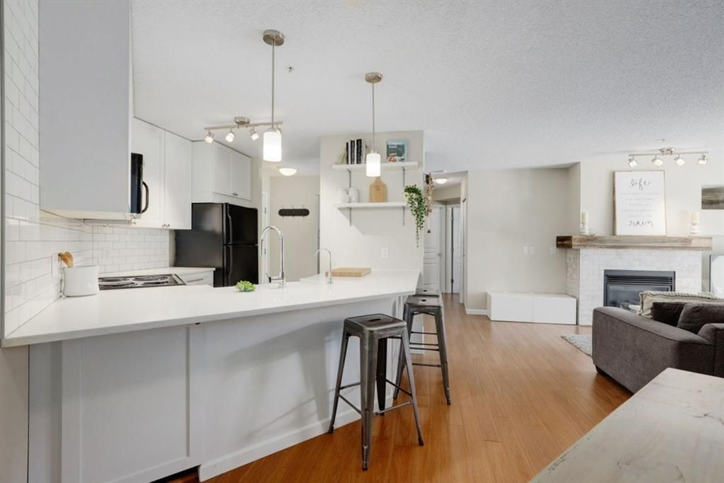 Upgraded kitchen with breakfast bar offering tons of additional seating space!