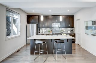 Photo 19: 1 310 12 Avenue NE in Calgary: Crescent Heights Row/Townhouse for sale : MLS®# A1112547