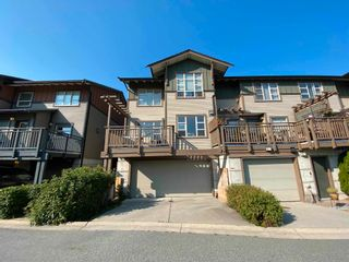 """Photo 1: 1214 VILLAGE GREEN Way in Squamish: Downtown SQ Townhouse for sale in """"TALON AT EAGLEWIND"""" : MLS®# R2599998"""