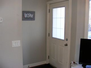 Photo 6: 203 2445 Kingsland Road SE: Airdrie Row/Townhouse for sale : MLS®# A1076272