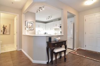 """Photo 7: 205 5556 201A Street in Langley: Langley City Condo for sale in """"Michaud Gardens"""" : MLS®# R2523718"""