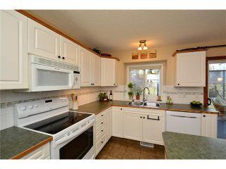 Photo 9: 108 GLENEAGLES Terrace: Cochrane House for sale : MLS®# C4113548