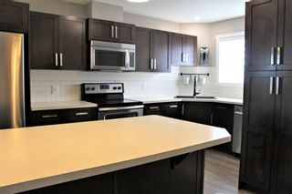 Photo 11: 1404 Clover Link: Carstairs Row/Townhouse for sale : MLS®# A1073804
