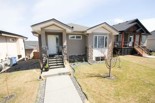 Photo 1: 646 Country Meadows Close: Turner Valley Detached for sale : MLS®# A1102004