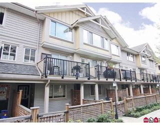 """Photo 1: 24 5388 201A Street in Langley: Langley City Townhouse for sale in """"THE COURTYARD"""" : MLS®# F2812450"""