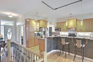 Photo 4: 31 Strathlea Common SW in Calgary: Strathcona Park Detached for sale : MLS®# A1147556