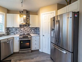 Photo 12: 27 Sandarac Road NW in Calgary: Sandstone Valley Row/Townhouse for sale : MLS®# A1148451