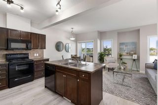 Photo 2: 407 620 Luxstone Landing SW: Airdrie Row/Townhouse for sale : MLS®# A1121530