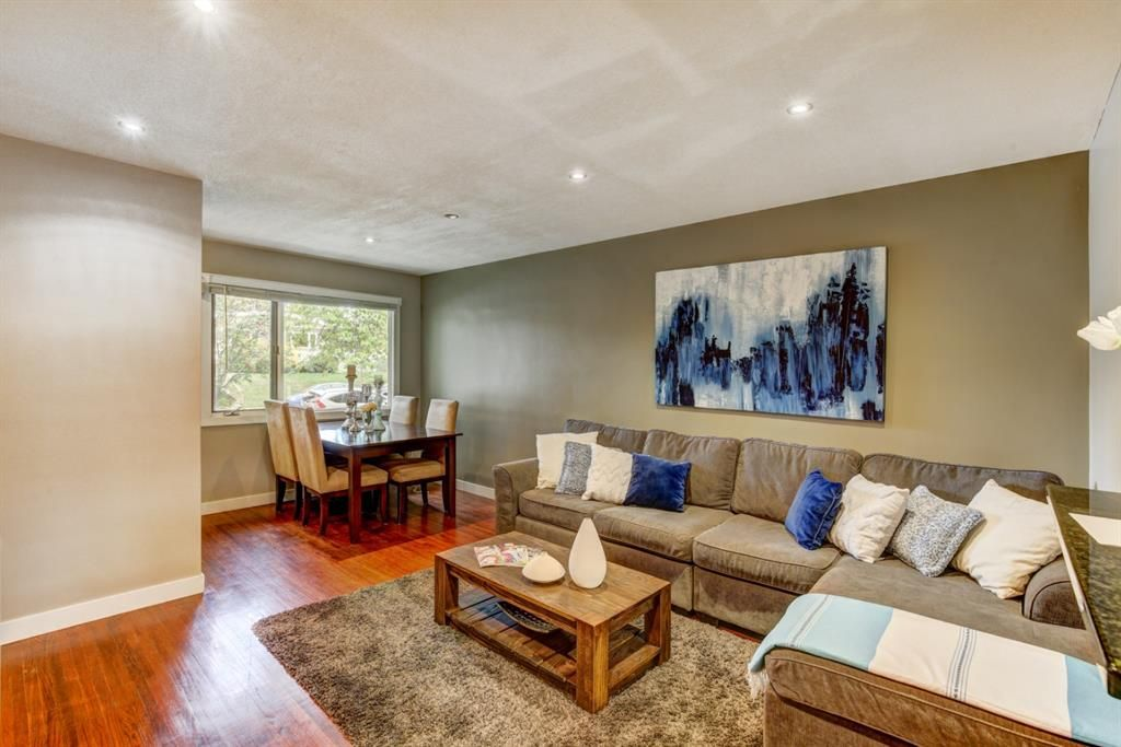 Cozy living room and dining with hardwood floors