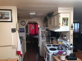 """Photo 3: 15830 SUFFOLK Drive in Surrey: Sunnyside Park Surrey Manufactured Home for sale in """"Cranley Place"""" (South Surrey White Rock)  : MLS®# R2589311"""