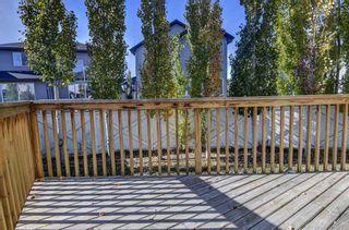 Photo 31: 128 Rainbow falls Grove E: Chestermere Duplex for sale : MLS®# A1154026