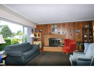 Photo 2: 817 COTTONWOOD Avenue in Coquitlam: Coquitlam West House for sale : MLS®# V1020762