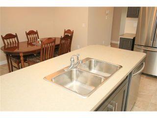 Photo 13: 7 FIRESIDE Parkway: Cochrane House for sale : MLS®# C4068645